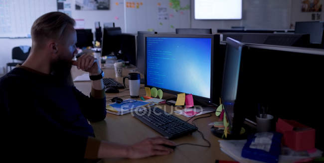 Attentive executive working on personal computer at desk in office — Stock Photo