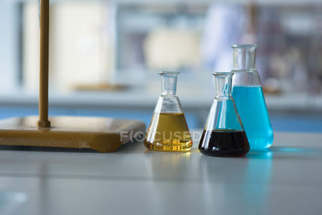 Close up of chemicals in beaker on table — Stock Photo
