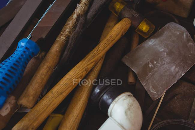 Various tools on worktop in workshop — Stock Photo