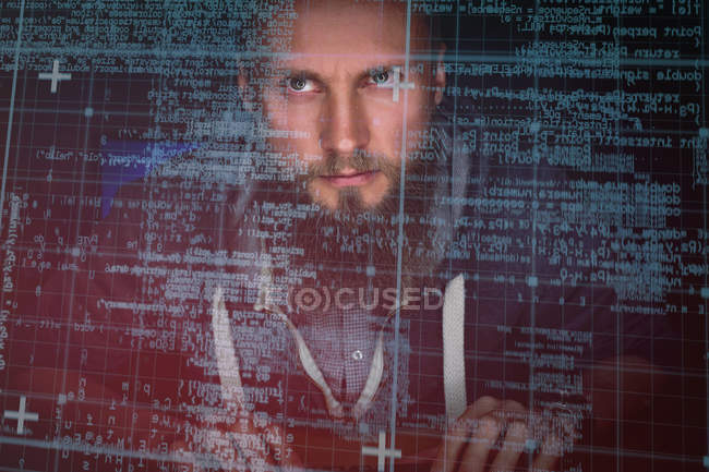 Attentive executive looking at futuristic screen in office — Stock Photo