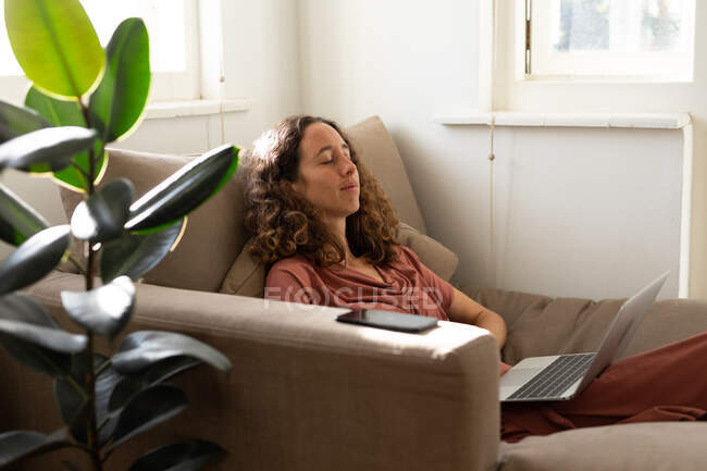 A Caucasian woman spending time at home, using her laptop. Lifestyle at home isolating, social distancing in quarantine lockdown during coronavirus covid 19 pandemic. — Stock Photo