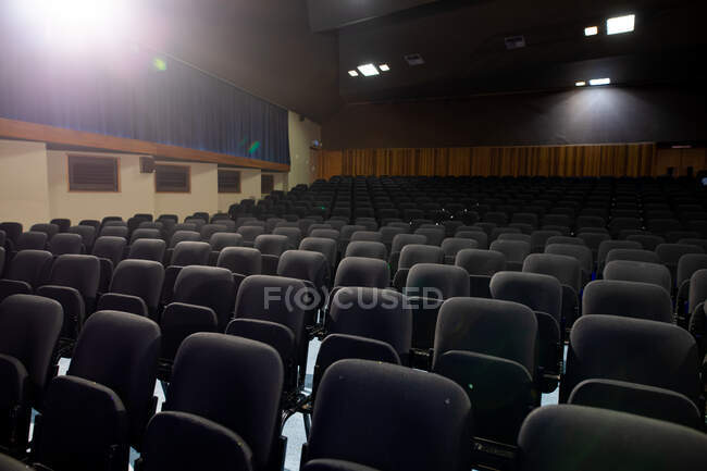 Empty seats in a school theatre auditorium, with the house lights on in a high school — Stock Photo