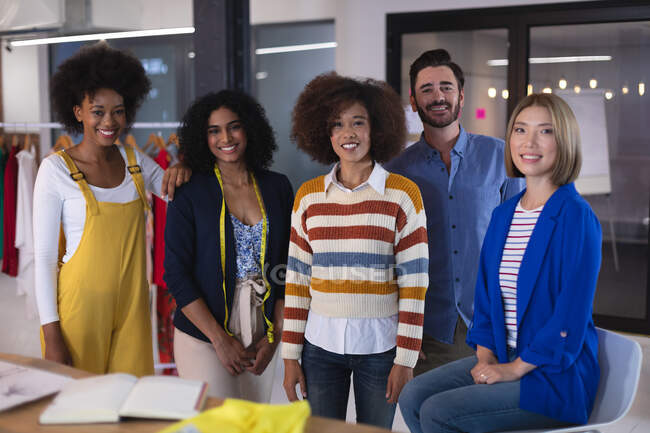 Portrait of creative fashion designer colleagues group looking to camera smiling. independent creative design business. — Stock Photo