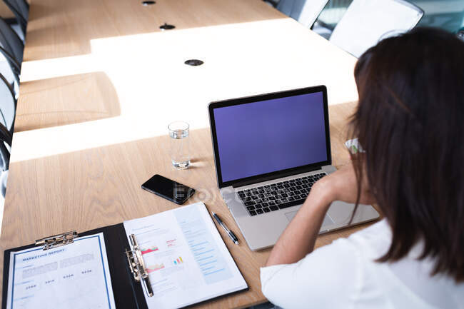 Caucasian businesswoman using laptop while sitting in meeting room at modern office. business and office concept — Stock Photo