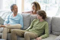 Happy family spending time together in living room at home — Stock Photo