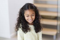Close-up of happy little girl smiling at home — Stock Photo
