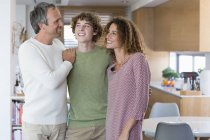Portrait of happy family standing at home — Stock Photo