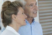 Close-up of happy senior couple head to head — Stock Photo