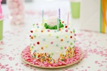 Close-up of birthday cake with candles, selective focus — Stock Photo