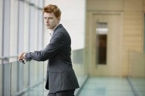 Portrait of young businessman staring in corridor — Stock Photo