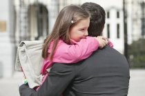 Cute girl hugging father outdoors — Stock Photo