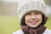 Portrait of smiling boy wearing knit hat outdoors — Stock Photo