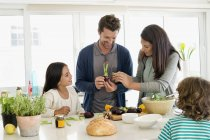 Happy family preparing food in kitchen — Stock Photo