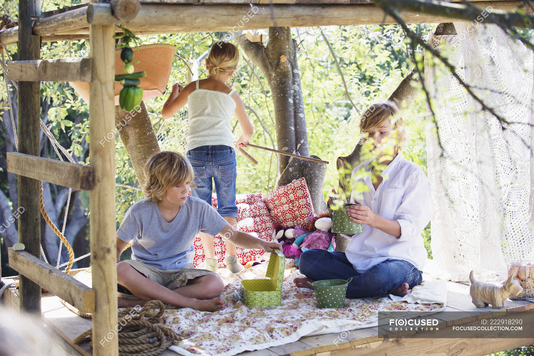 Picture of: Children Playing In Tree House In Summer Garden Housing Happiness Stock Photo 222918290