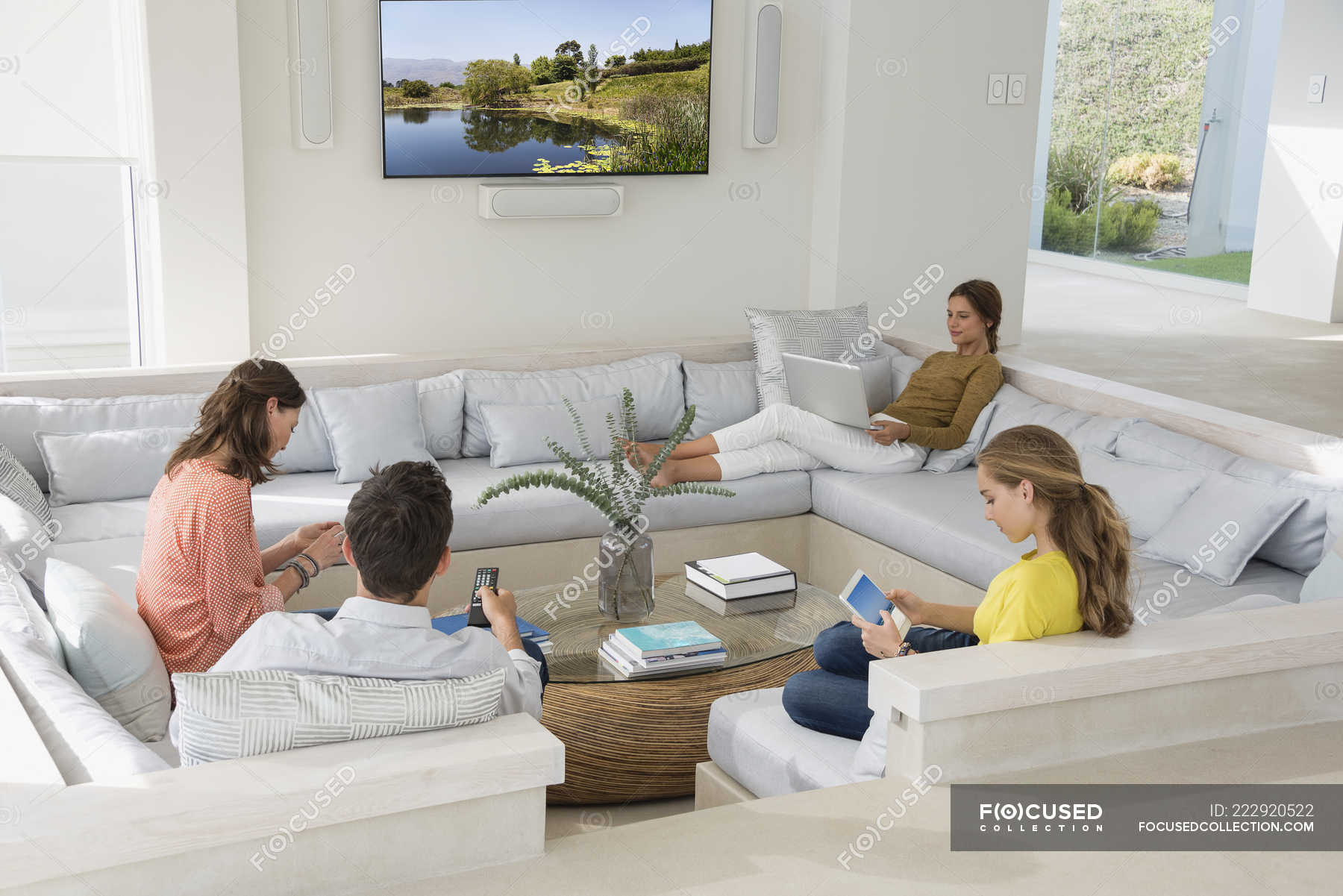 Multi-generation family using gadgets in living room ...