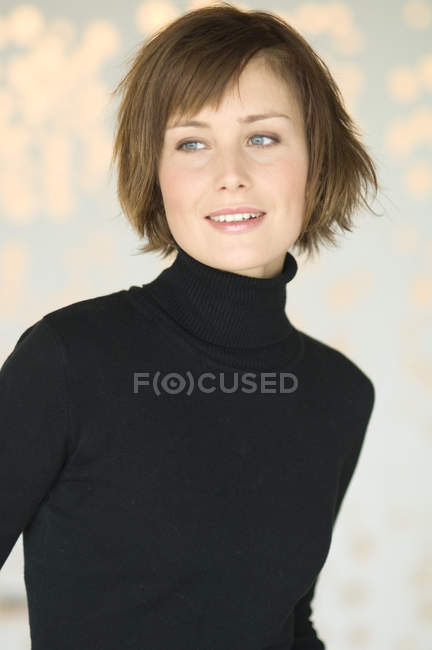 Portrait of woman with short hair looking away — Stock Photo