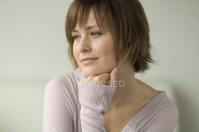 Portrait of smiling woman with short hair looking away — Stock Photo