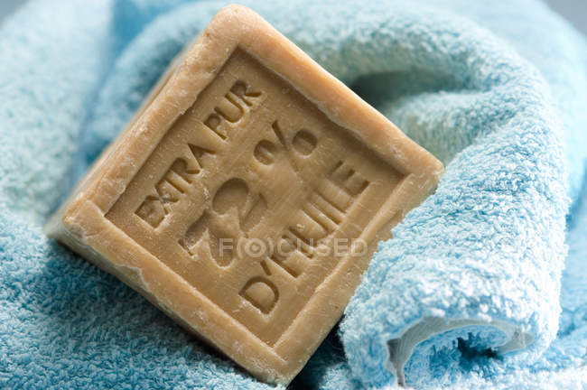 Close-up of natural soap on blue towel — Stock Photo