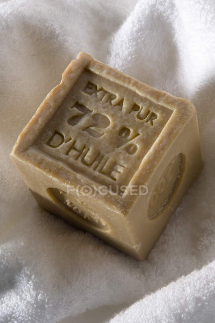 Close-up of natural soap on white towel — Stock Photo
