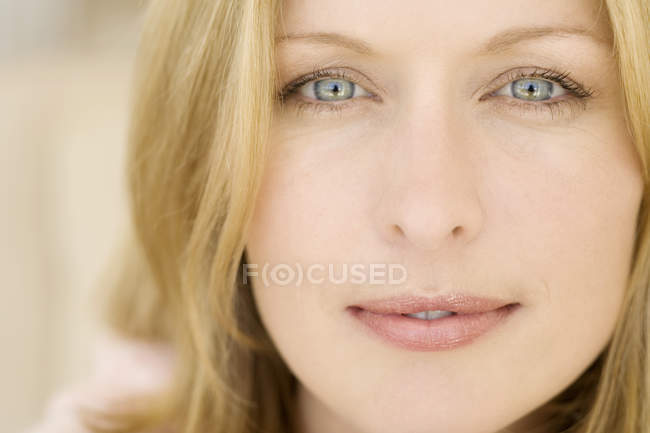 Portrait of blond young woman looking at camera — Stock Photo
