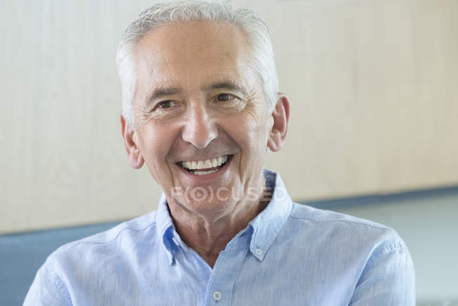 Portrait of happy senior man looking away — Stock Photo