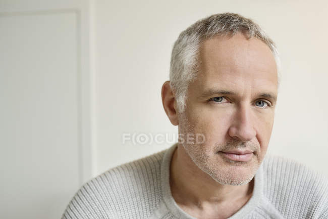 Portrait of confident grey haired mature man — Stock Photo