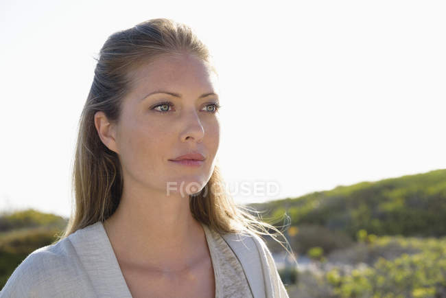 Close-up of elegant woman looking away outdoors — Stock Photo