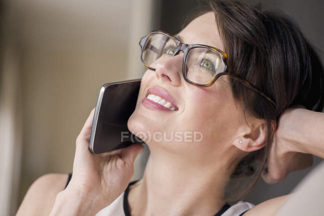 Close-up of woman talking on mobile phone — Stock Photo