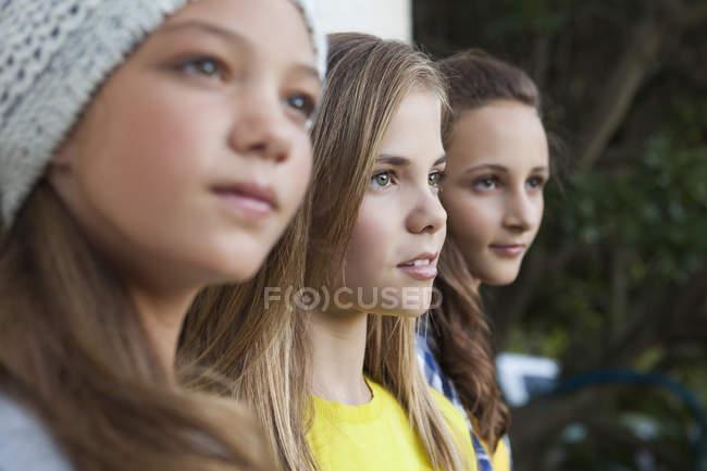 Close-up of three teenage girls staring outdoors — Stock Photo