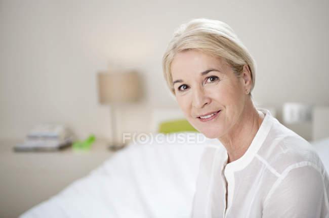Portrait of elegant senior woman smiling — Stock Photo