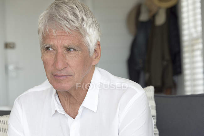 Close-up of thoughtful senior man at home — Stock Photo