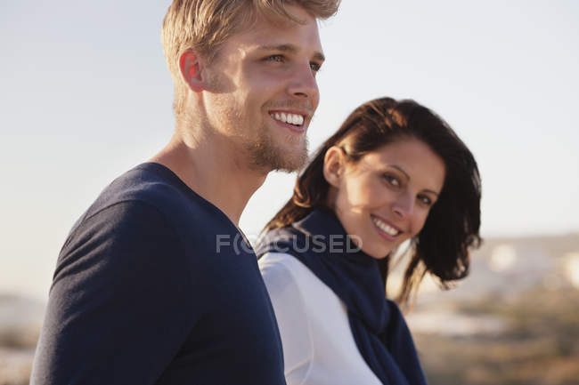 Close-up of couple smiling while walking outdoors — Stock Photo