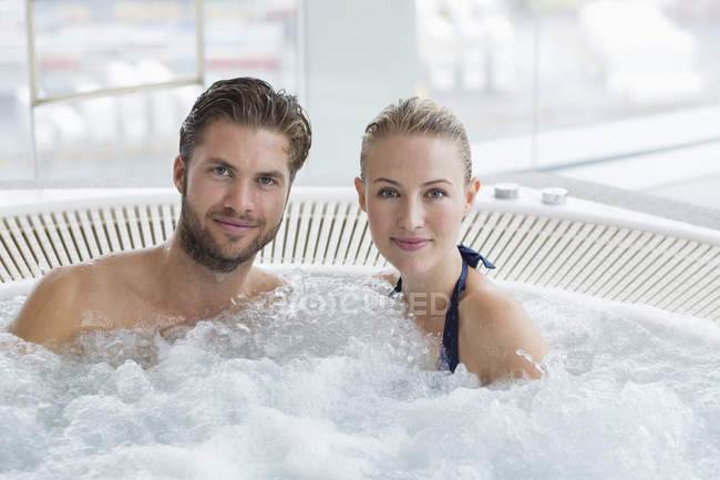 Portrait of relaxed couple resting in hot tub — Stock Photo
