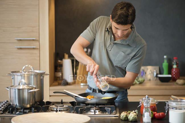 Man preparing food in modern kitchen — Stock Photo