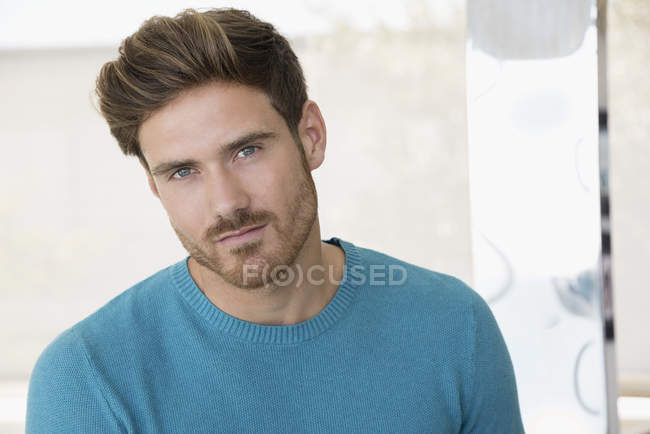 Portrait of a handsome young man looking at camera — Stock Photo