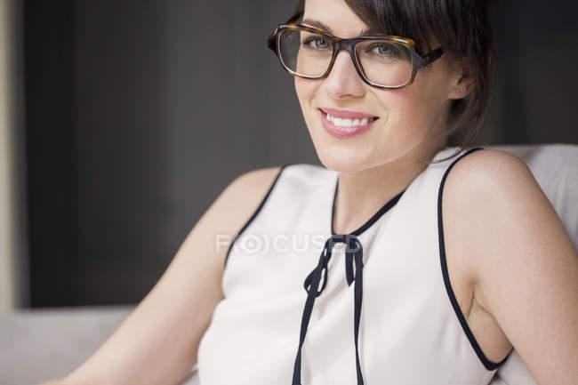 Portrait of smiling elegant woman in glasses — Stock Photo