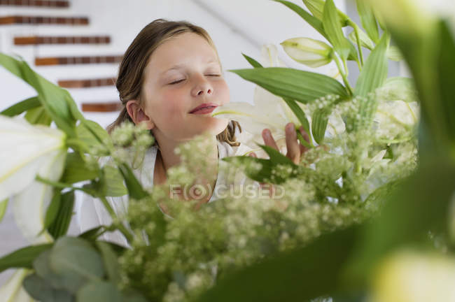 Cute girl smelling fragrance of leaves — Stock Photo