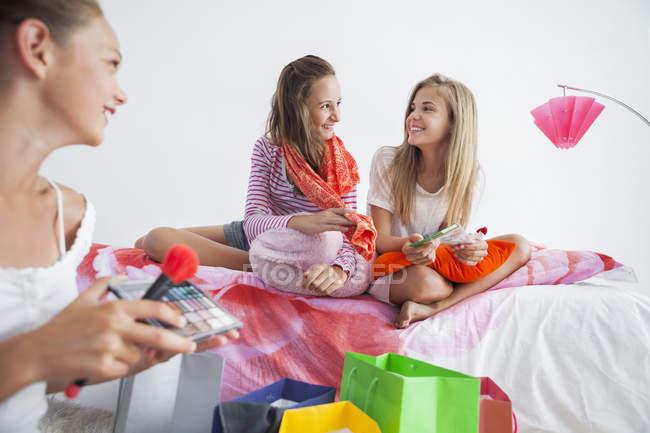 Cheerful teenage girls enjoying good time at slumber party — Stock Photo