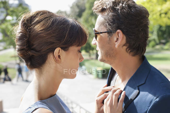 Romantic couple standing in park together — Stock Photo