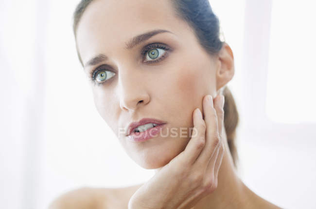 Portrait of smiling woman with elegant makeup looking away — Stock Photo
