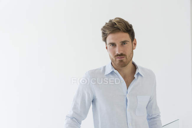 Portrait of elegant young man in white shirt looking at camera — Stock Photo