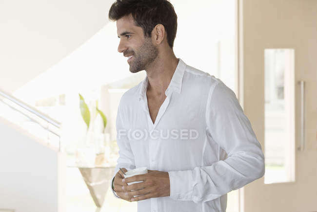 Happy man enjoying cup of coffee at home — Stock Photo