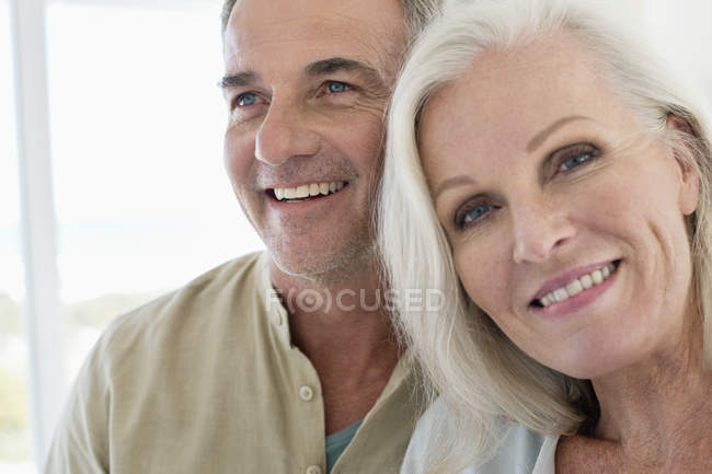 Close-up of romantic smiling senior couple — Stock Photo