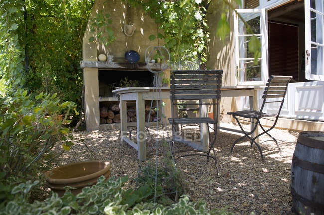 Wooden furniture on backyard of countryside house — Stock Photo