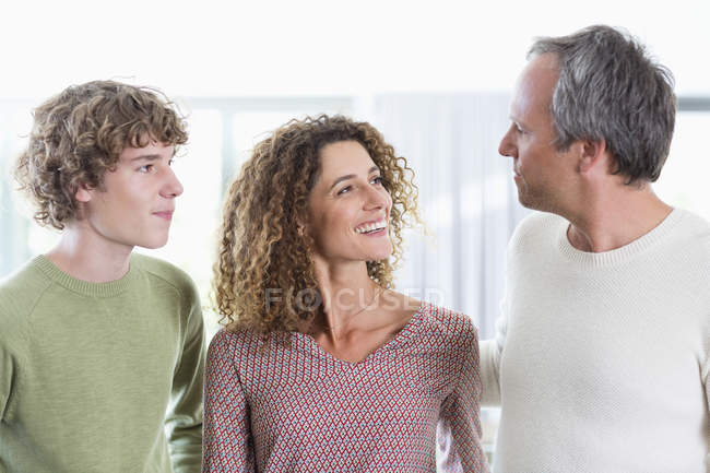 Portrait of happy family smiling at home — Stock Photo
