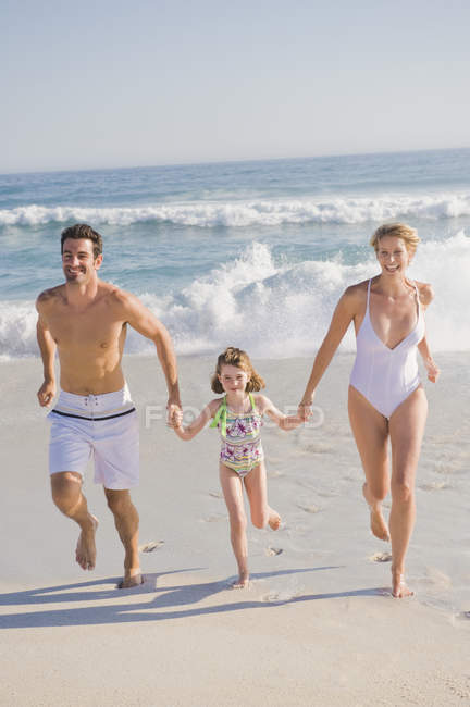 Family enjoying vacations on sandy beach — Stock Photo
