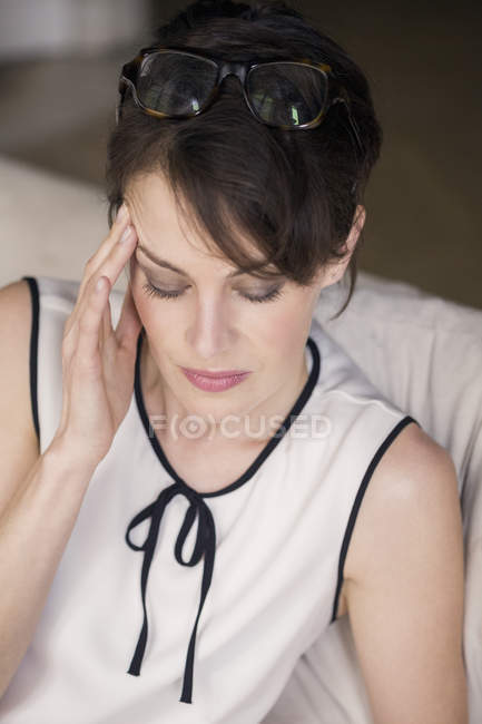 Close-up of woman with eyes closed suffering from headache — Stock Photo