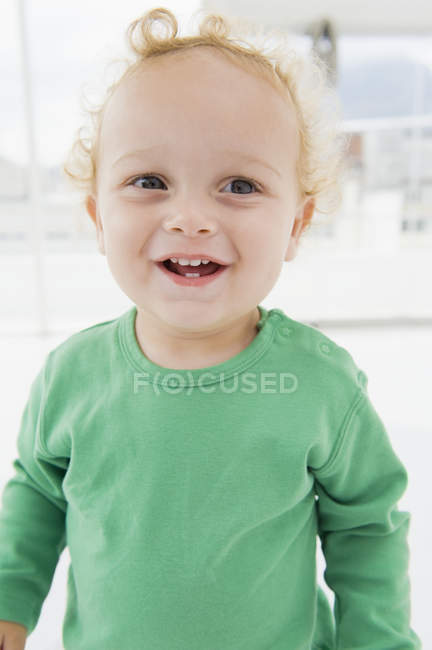 Close-up of cute smiling baby boy on blurred background — Stock Photo
