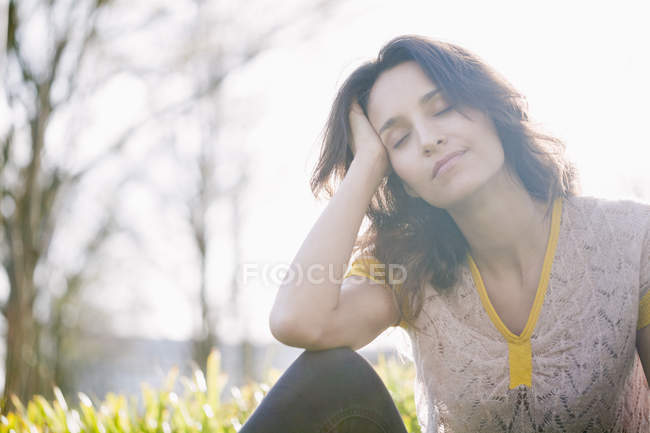 Dreamy woman with eyes closed relaxing in nature — Stock Photo