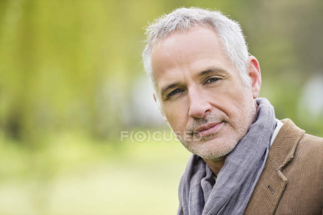 Portrait of confident happy mature man outdoors — Stock Photo